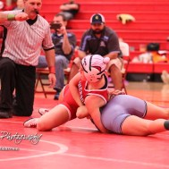 Mya Kretzer (McPherson) tries to reverse a hold by Sunny O'Leary (Riley County). Kratzer won the match by pin fall. The first ever Kansas High School Girls Wrestling Championship was held at the Roundhouse at McPherson High School in McPherson, Kansas on February 11, 2017. (Photo: Joey Bahr, www.joeybahr.com)