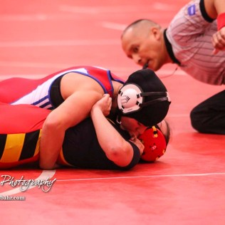 Mariyah Reyes (Dodge City) pins Abbie Jones (Altamont-Labette County) to win the match. The first ever Kansas High School Girls Wrestling Championship was held at the Roundhouse at McPherson High School in McPherson, Kansas on February 11, 2017. (Photo: Joey Bahr, www.joeybahr.com)