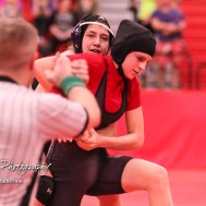 Kacie Jones (Burlingame) looks at a call from an official as she holds on to Montana Grahem (Jefferson West). Jones won the match by fall. The first ever Kansas High School Girls Wrestling Championship was held at the Roundhouse at McPherson High School in McPherson, Kansas on February 11, 2017. (Photo: Joey Bahr, www.joeybahr.com)