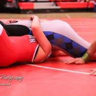 Tia Hayworth (Lincoln) pins Katelyn Simmons (McPherson) to win the match by fall. The first ever Kansas High School Girls Wrestling Championship was held at the Roundhouse at McPherson High School in McPherson, Kansas on February 11, 2017. (Photo: Joey Bahr, www.joeybahr.com)