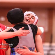 Tia Hayworth (Lincoln) embraces Katelyn Simmons (McPherson) following their match that Hayworth won by fall. The first ever Kansas High School Girls Wrestling Championship was held at the Roundhouse at McPherson High School in McPherson, Kansas on February 11, 2017. (Photo: Joey Bahr, www.joeybahr.com)