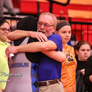 Tia Hayworth (Lincoln) hugs her coach John Gardner following her final match of the day. The first ever Kansas High School Girls Wrestling Championship was held at the Roundhouse at McPherson High School in McPherson, Kansas on February 11, 2017. (Photo: Joey Bahr, www.joeybahr.com)