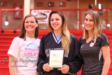 Lyric Conclaves of Clearwater accepts the Most Outstanding Wrestler trophy. Katherine Shai and Sally Roberts of Wrestle Like a Girl join her for a photo. The first ever Kansas High School Girls Wrestling Championship was held at the Roundhouse at McPherson High School in McPherson, Kansas on February 11, 2017. (Photo: Joey Bahr, www.joeybahr.com)