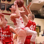 Great Bend Panther #2 Ty Esfeld goes for a layup as McPherson Bullpup #41 Wyatt Seidl defends. The McPherson Bullpups defeated the Great Bend Panthers with a score of 57 to 30 at the Great Bend High School Fieldhouse in Great Bend, Kansas on February 7, 2017. (Photo: Joey Bahr, www.joeybahr.com)