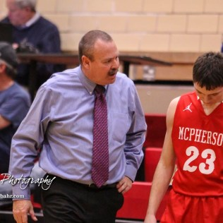 McPherson Bullpup Head Coach Kurt Kinnamon discusses a play with #23 Kyler Hoppes. The McPherson Bullpups defeated the Great Bend Panthers with a score of 57 to 30 at the Great Bend High School Fieldhouse in Great Bend, Kansas on February 7, 2017. (Photo: Joey Bahr, www.joeybahr.com)