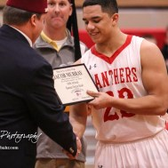 Darin Martin with the Kansas Shriners presents Great Bend Panther #23 Jacob Murray with a plaque for being accepted to play in the 44th Kansas Shrine Bowl this summer. The McPherson Bullpups defeated the Great Bend Panthers with a score of 57 to 30 at the Great Bend High School Fieldhouse in Great Bend, Kansas on February 7, 2017. (Photo: Joey Bahr, www.joeybahr.com)