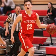 McPherson Bullpup #12 Mason Alexander brings the ball down the court. The McPherson Bullpups defeated the Great Bend Panthers with a score of 57 to 30 at the Great Bend High School Fieldhouse in Great Bend, Kansas on February 7, 2017. (Photo: Joey Bahr, www.joeybahr.com)