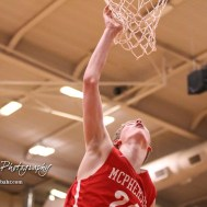 McPherson Bullpup #24 Ben Pyle tries to dunk the ball. The McPherson Bullpups defeated the Great Bend Panthers with a score of 57 to 30 at the Great Bend High School Fieldhouse in Great Bend, Kansas on February 7, 2017. (Photo: Joey Bahr, www.joeybahr.com)