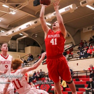 McPherson Bullpup #41 Wyatt Seidl sends Great Bend Panther #11 Konner Ireland flying as he goes for a layup. The McPherson Bullpups defeated the Great Bend Panthers with a score of 57 to 30 at the Great Bend High School Fieldhouse in Great Bend, Kansas on February 7, 2017. (Photo: Joey Bahr, www.joeybahr.com)