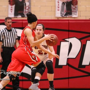Great Bend Lady Panther #21 Kate Warren defends McPherson Lady Bullpup #35 Jordan Bruner. The McPherson Lady Bullpups defeated the Great Bend Lady Panthers with a score of 69 to 38 at the Great Bend High School Fieldhouse in Great Bend, Kansas on February 7, 2017. (Photo: Joey Bahr, www.joeybahr.com)