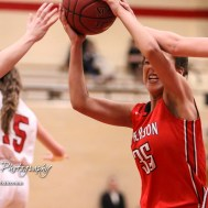 McPherson Lady Bullpup #35 Jordan Bruner tries to bring the ball through two Great Bend Lady Panther defenders. The McPherson Lady Bullpups defeated the Great Bend Lady Panthers with a score of 69 to 38 at the Great Bend High School Fieldhouse in Great Bend, Kansas on February 7, 2017. (Photo: Joey Bahr, www.joeybahr.com)