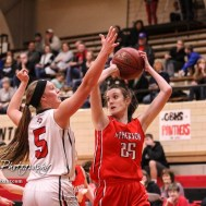 Great Bend Lady Panther #5 Camryn Dunekack defends as McPherson Lady Bullpup #25 Andrea Sweat looks for a teammate to pass the ball to. The McPherson Lady Bullpups defeated the Great Bend Lady Panthers with a score of 69 to 38 at the Great Bend High School Fieldhouse in Great Bend, Kansas on February 7, 2017. (Photo: Joey Bahr, www.joeybahr.com)