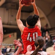 McPherson Lady Bullpup #40 Mandi Cooks rises above the defense to pull in a pass. The McPherson Lady Bullpups defeated the Great Bend Lady Panthers with a score of 69 to 38 at the Great Bend High School Fieldhouse in Great Bend, Kansas on February 7, 2017. (Photo: Joey Bahr, www.joeybahr.com)