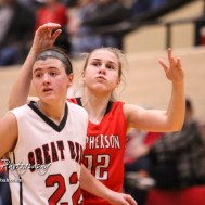 McPherson Lady Bullpup #12 Hannah Hageman watches her shot go to the basket as Great Bend Lady Panther #22 Carley Brack defends. The McPherson Lady Bullpups defeated the Great Bend Lady Panthers with a score of 69 to 38 at the Great Bend High School Fieldhouse in Great Bend, Kansas on February 7, 2017. (Photo: Joey Bahr, www.joeybahr.com)