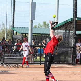Great Bend Lady Panther #13 Hunter Marcum catches an infield fly ball to record the first out of the game. The Great Bend Lady Panthers defeated the Dodge City Lady Demons 15 to 5 at the Great Bend Sports Complex in Great Bend, Kansas on April 18, 2017. (Photo: Joey Bahr, www.joeybahr.com)