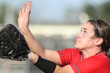 Great Bend Lady Panther #24 Mikayla Bownes lines up a popped up ball with her glove. The Great Bend Lady Panthers defeated the Dodge City Lady Demons 15 to 5 at the Great Bend Sports Complex in Great Bend, Kansas on April 18, 2017. (Photo: Joey Bahr, www.joeybahr.com)