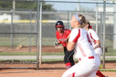 Great Bend Lady Panther #21 Emma Cape watches Dodge City Lady Demon #4 Reagan Lopp start a pitch in the Bottom of the 1st Inning. The Great Bend Lady Panthers defeated the Dodge City Lady Demons 15 to 5 at the Great Bend Sports Complex in Great Bend, Kansas on April 18, 2017. (Photo: Joey Bahr, www.joeybahr.com)