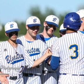 Teammates greet Bluestem Lion #3 Coy Moran during player introductions prior to the game. The Bluestem Lions defeated the Ellis Railroaders 8 to 5 in the KSHSAA Class 2-1A State Baseball Championship game at Great Bend Sports Complex in Great Bend, Kansas on May 26, 2017. (Photo: Joey Bahr, www.joeybahr.com)