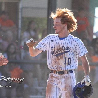 Bluestem Lion #10 Dakota Clift celebrates scoring the first run of the game in the top of the first inning. The Bluestem Lions defeated the Ellis Railroaders 8 to 5 in the KSHSAA Class 2-1A State Baseball Championship game at Great Bend Sports Complex in Great Bend, Kansas on May 26, 2017. (Photo: Joey Bahr, www.joeybahr.com)