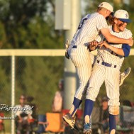 Bluestem Lion #8 Hunter Clift jumps and hugs #14 Jacob Lanier at the conclusion of the game. The Bluestem Lions defeated the Ellis Railroaders 8 to 5 in the KSHSAA Class 2-1A State Baseball Championship game at Great Bend Sports Complex in Great Bend, Kansas on May 26, 2017. (Photo: Joey Bahr, www.joeybahr.com)