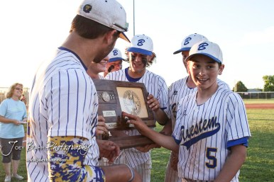 Bluestem Lion #5 Timothy Reyes touches the State Championship trophy to make sure it is real. The Bluestem Lions defeated the Ellis Railroaders 8 to 5 in the KSHSAA Class 2-1A State Baseball Championship game at Great Bend Sports Complex in Great Bend, Kansas on May 26, 2017. (Photo: Joey Bahr, www.joeybahr.com)