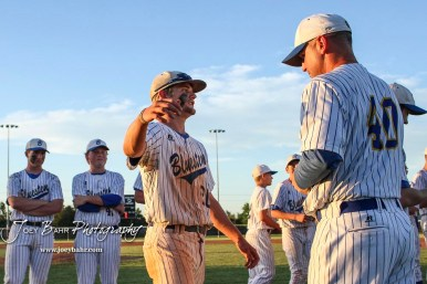 Winning Pitcher #20 Blake Bevan goes to hug his coach, Daniel Scribner, during the medal presentation following the game. The Bluestem Lions defeated the Ellis Railroaders 8 to 5 in the KSHSAA Class 2-1A State Baseball Championship game at Great Bend Sports Complex in Great Bend, Kansas on May 26, 2017. (Photo: Joey Bahr, www.joeybahr.com)