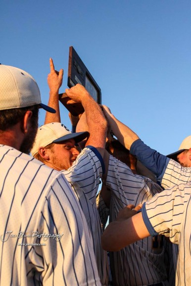 The Bluestem Lions hold up the State Championship trophy after a team huddle. The Bluestem Lions defeated the Ellis Railroaders 8 to 5 in the KSHSAA Class 2-1A State Baseball Championship game at Great Bend Sports Complex in Great Bend, Kansas on May 26, 2017. (Photo: Joey Bahr, www.joeybahr.com)