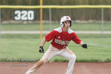 Hoisington Cardinal #14 Alex Schremmer gets a lead from the bag and watches the pitch in the top of the third inning. The Pratt Greenbacks defeated the Hoisington Cardinals 12 to 0 at Bicentennial Park in Hoisington, Kansas on May 9, 2017. (Photo: Joey Bahr, www.joeybahr.com)