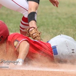Hays Eagle Brady Kreutzer (#21) gets back to the back as Great Bend Chief Brayden Smith (#9) tries to tag him out in the top of the first inning. He was ruled safe. The Great Bend American Legion Post 180 AAA Cheifs defeated the Hays American Legion Post 173 AAA Eagles 3 to 1 to advance to the AAA Zone 8 Championship at the Great Bend Sports Complex in Great Bend, Kansas on July 15, 2017. (Photo: Joey Bahr, www.joeybahr.com)