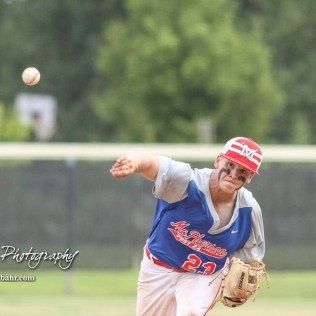 McPherson Senior Dylan Werries (#23) throws a pitch in the top of the third inning. The McPherson American Legion Post 24 AAA Seniors defeated the Hutchinson American Legion Post 68 AAA Colts 6 to 4 to advance to the AAA Zone 8 Championship at the Great Bend Sports Complex in Great Bend, Kansas on July 15, 2017. (Photo: Joey Bahr, www.joeybahr.com)