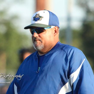 Great Bend Batcat Head Coach Roger Ward studies the situation on the field. The Great Bend Batcats won the second game of the series with the Liberal Bee Jays 8 to 3 at Al Burns Memorial Field in Great Bend, Kansas on July 8, 2017. (Photo: Joey Bahr, www.joeybahr.com)