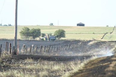 A range truck from the Galatia Fire Department goes to look for hotspots along a fence row. Members of the Olmitz, Hoisington, and Galatia Fire Departments respond to a controlled burn that got out of control two miles north of the junction of Kansas Highway 4 and US Highway 281 near Hoisington, Kansas on July 1, 2017. (Photo: Joey Bahr, www.joeybahr.com)