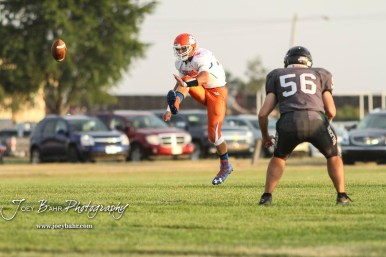 Otis-Bison Cougar #17 Anton Foust kicks off the ball as Central Plains Oiler #56 Kealy Burris watches it fly in the first quarter. The Central Plains Oilers defeated the Otis-Bison Cougars by a score of 36 to 12 at Central Plains High School in Claflin, Kansas on September 15, 2017. (Photo: Joey Bahr, www.joeybahr.com)