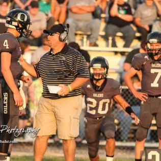 Central Plains Oiler Head Coach Chris Steiner gives the next play to #4 Myles Menges in the first quarter. The Central Plains Oilers defeated the Otis-Bison Cougars by a score of 36 to 12 at Central Plains High School in Claflin, Kansas on September 15, 2017. (Photo: Joey Bahr, www.joeybahr.com)