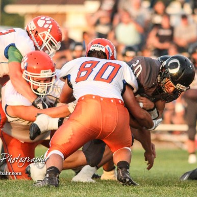 Otis-Bison Cougar #80 Seth Hoopingarner tries to tackle Central Plains Oiler #20 Jerred Bieberle in the first quarter. The Central Plains Oilers defeated the Otis-Bison Cougars by a score of 36 to 12 at Central Plains High School in Claflin, Kansas on September 15, 2017. (Photo: Joey Bahr, www.joeybahr.com)