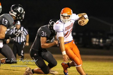 Central Plains Oiler #36 Lee Letourneau tries to pull down Otis-Bison Cougar #17 Anton Foust in the third quarter. The Central Plains Oilers defeated the Otis-Bison Cougars by a score of 36 to 12 at Central Plains High School in Claflin, Kansas on September 15, 2017. (Photo: Joey Bahr, www.joeybahr.com)