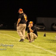 The Otis-Bison Cougar coaching staff react to the latest Central Plains Oiler touchdown in the fourth quarter. The Central Plains Oilers defeated the Otis-Bison Cougars by a score of 36 to 12 at Central Plains High School in Claflin, Kansas on September 15, 2017. (Photo: Joey Bahr, www.joeybahr.com)