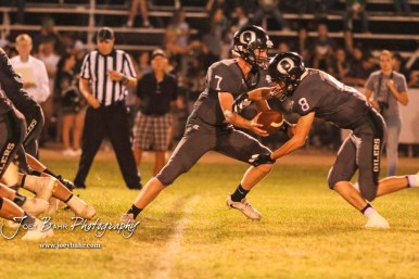 Central Plains Oiler #7 Devin Ryan hands the ball off to #8 Anthony Oberle in the fourth quarter. The Central Plains Oilers defeated the Otis-Bison Cougars by a score of 36 to 12 at Central Plains High School in Claflin, Kansas on September 15, 2017. (Photo: Joey Bahr, www.joeybahr.com)