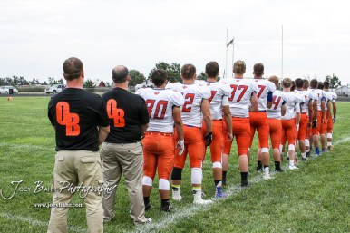 The Otis-Bison Cougars line up for the National Anthem prior to the start of the game. The Otis-Bison Cougars defeated the St. John Tigers by a score of 58 to 0 at St. John High School in St. John, Kansas on September 1, 2017. (Photo: Joey Bahr, www.joeybahr.com)