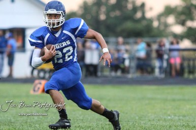 St. John Tiger #22 Keven Neri Leon rushes with the ball in the first quarter. The Otis-Bison Cougars defeated the St. John Tigers by a score of 58 to 0 at St. John High School in St. John, Kansas on September 1, 2017. (Photo: Joey Bahr, www.joeybahr.com)