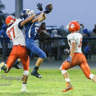 Otis-Bison Cougar #87 Maitland Wiltse breaks up a pass intended for St. John Tiger #5 Jorden Taylor in the second quarter. The Otis-Bison Cougars defeated the St. John Tigers by a score of 58 to 0 at St. John High School in St. John, Kansas on September 1, 2017. (Photo: Joey Bahr, www.joeybahr.com)