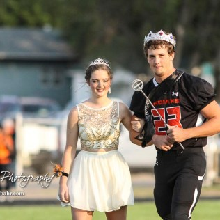 Larned Indian Wes Davis (#23) and Megan Stelter walk forward as the Homecoming King and Queen. The Larned Indians defeated the Smoky Valley Vikings by a score of 28 to 14 at Earl Roberts Stadium in Larned, Kansas on September 8, 2017. (Photo: Joey Bahr, www.joeybahr.com)