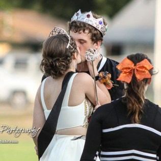 Larned Indian Wes Davis (#23) kisses Megan Stelter after crowning her the Homecoming Queen. The Larned Indians defeated the Smoky Valley Vikings by a score of 28 to 14 at Earl Roberts Stadium in Larned, Kansas on September 8, 2017. (Photo: Joey Bahr, www.joeybahr.com)