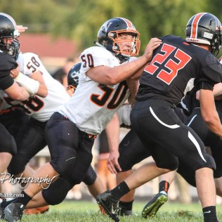 Smoky Valley Viking Konrad Peterson (#50) blocks Larned Indian Wes Davis (#23) during a running play in the first quarter. The Larned Indians defeated the Smoky Valley Vikings by a score of 28 to 14 at Earl Roberts Stadium in Larned, Kansas on September 8, 2017. (Photo: Joey Bahr, www.joeybahr.com)