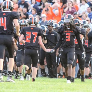 Larned Indian Damontay Phillips (#3) congratulates Mason Burris (#27) after a vital defensive stop in the first quarter. The Larned Indians defeated the Smoky Valley Vikings by a score of 28 to 14 at Earl Roberts Stadium in Larned, Kansas on September 8, 2017. (Photo: Joey Bahr, www.joeybahr.com)