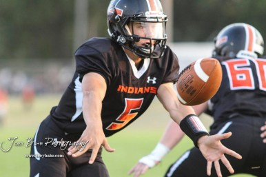 Larned Indian Carson Smith (#5) tosses the ball to a teammate in the backfield in the first quarter. The Larned Indians defeated the Smoky Valley Vikings by a score of 28 to 14 at Earl Roberts Stadium in Larned, Kansas on September 8, 2017. (Photo: Joey Bahr, www.joeybahr.com)