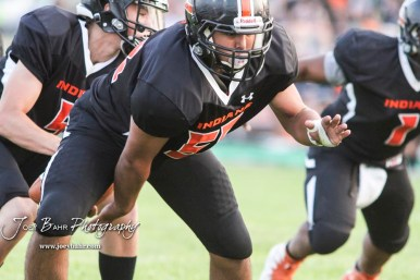 Larned Indian Brandon Ceniceros (#58) hikes the ball to Quarterback Carson Smith (#5) in the second quarter. The Larned Indians defeated the Smoky Valley Vikings by a score of 28 to 14 at Earl Roberts Stadium in Larned, Kansas on September 8, 2017. (Photo: Joey Bahr, www.joeybahr.com)