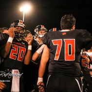 Larned Indian Christian Martinez (#70) pumps up his teammates in a post game huddle. The Larned Indians defeated the Smoky Valley Vikings by a score of 28 to 14 at Earl Roberts Stadium in Larned, Kansas on September 8, 2017. (Photo: Joey Bahr, www.joeybahr.com)
