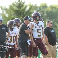 Victoria Knight Head Coach Doug Oberle gives the next play to #5 Collin Kisner in the second quarter. The Victoria Knights defeated the Central Plains Oilers by a score of 34 to 8 at Central Plains High School in Claflin, Kansas on September 2, 2017. (Photo: Joey Bahr, www.joeybahr.com)