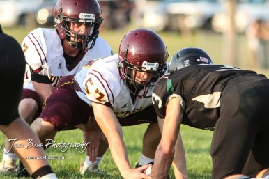 Victoria Knight #57 Wyatt Engel prepares to hike the ball to #7 Cooper Windholz in the third quarter. The Victoria Knights defeated the Central Plains Oilers by a score of 34 to 8 at Central Plains High School in Claflin, Kansas on September 2, 2017. (Photo: Joey Bahr, www.joeybahr.com)